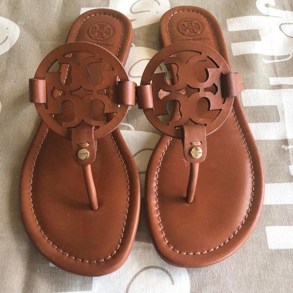 d60346161 Tory Burch Miller Flat Leather Logo Slide Sandal. M 5b8f276ade6f6279cbfd86c3